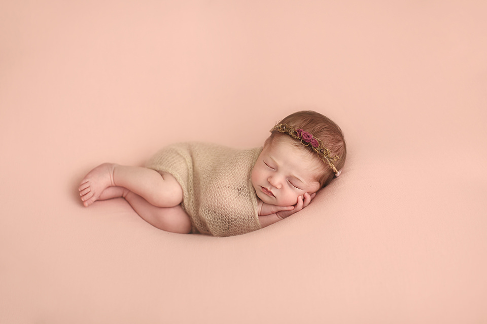 Newborn Photography London | portrait of a newborn baby girl sleeping on her side during a professional newborn photo session