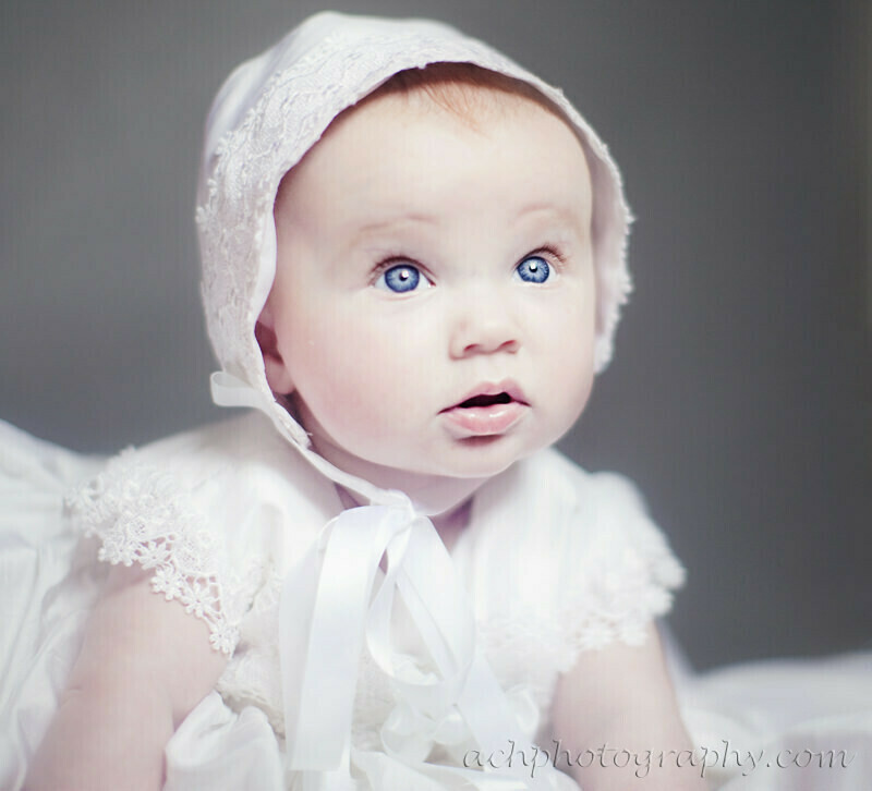 baby images london | portrait of 5 months old girl wearing her Christening gown and bonet