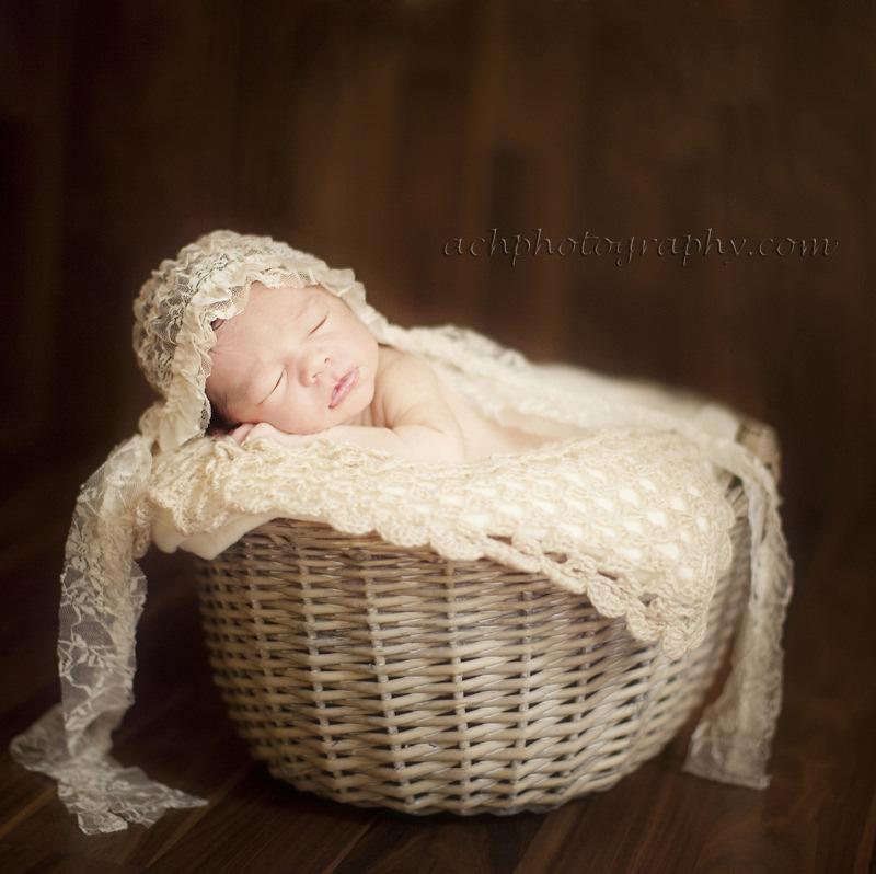 London Newborn Photos | newborn baby girl in wicker basket