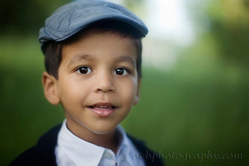 London kids photo session  | a close up portrait of 3.5 years old boy wearing a blue flat cap