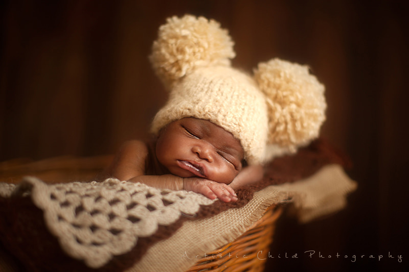 Professional London newborn photographer | newborn baby boy wearing pompon hat