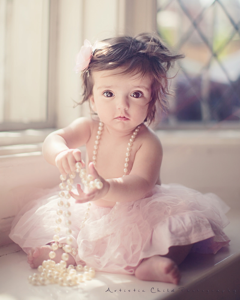 8 months old baby girl wearing tutu and pearls london photography