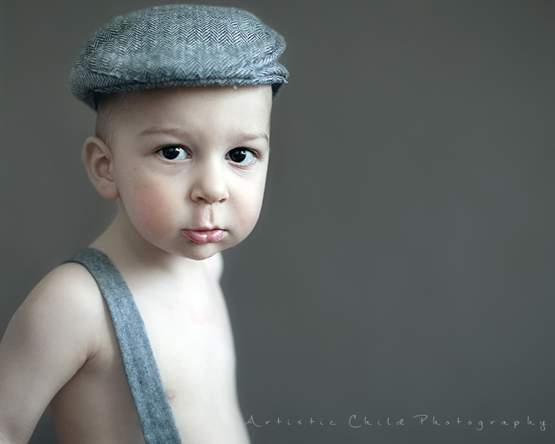 London Child Pictures London | a close up portrait of a 1.5 year old boy in a flat cap