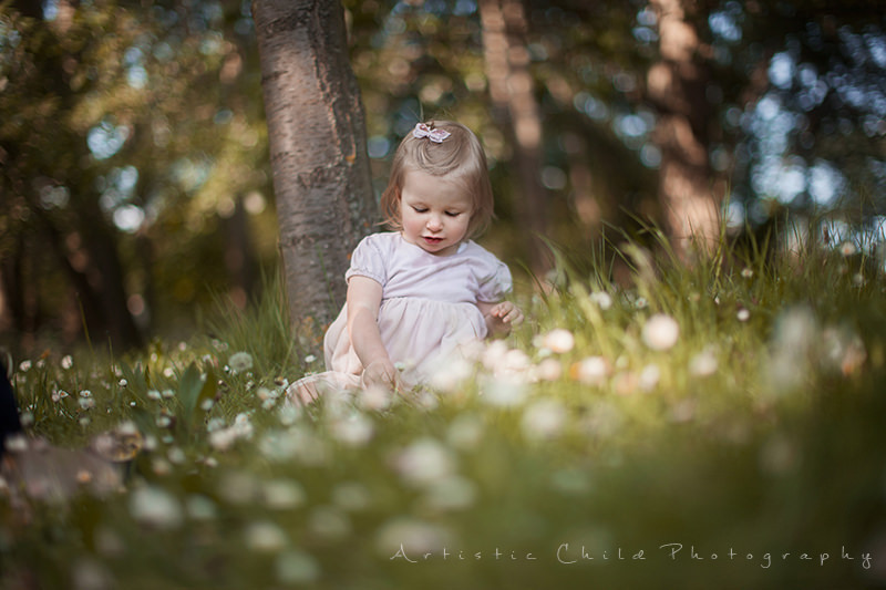a photo of 17 month old girl sitting in the grass | South East London park