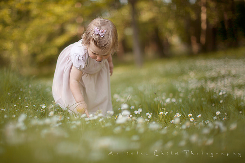 Toddler girl picking flowers in Crystal Palace Park | South East London