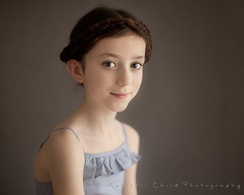 7 years old girl wearing plait around her hair | London studio portrait