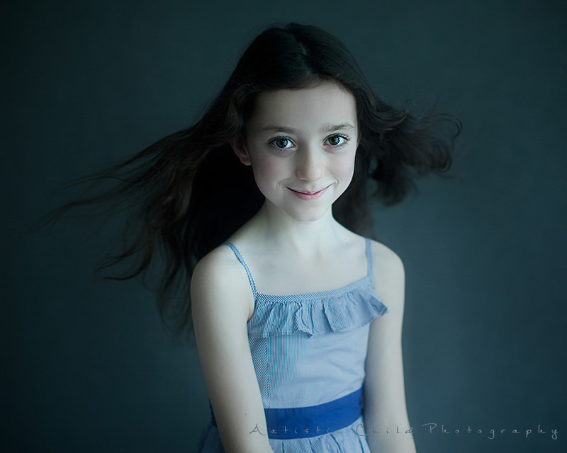 London Kids Photos | portrait of 7 years old girl with wind blown hair