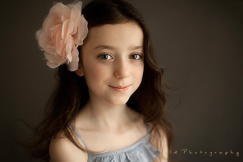 London Kids Photos | a girl with big flower in her hair