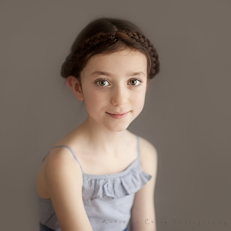 London Kids Photos | traditional image of a red hair girl wearing Plait