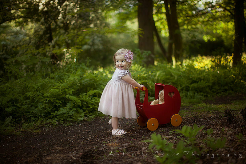 London Toddler Pictures | 17 months old girl with red wooden mover in the Crystal Palace Park