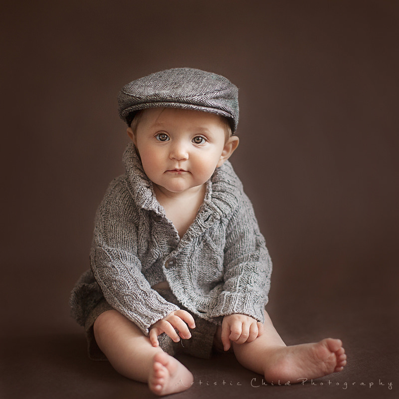 Professional London Baby Pictures | 9 month old baby girl in flat cap, shorts and grand dad cardigan