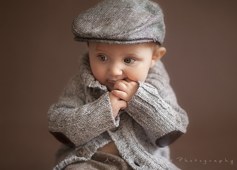 Professional London Baby Pictures | baby girl dressed in a boy style looking away