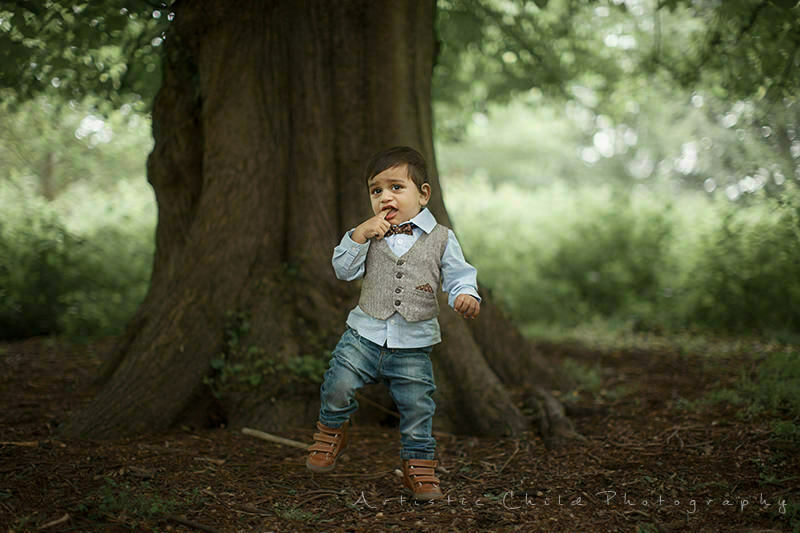 Richmond Toddler Photography | 1 year old boy standing on 1 leg in fron of giant tree
