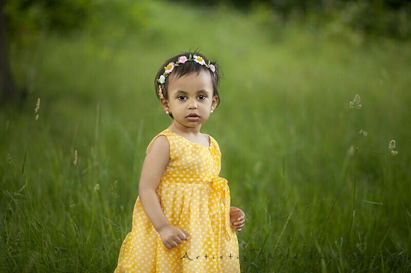 photo of toddler girl wearing yellow dress | London