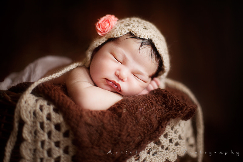 London Newborn Images | newborn baby girl in a cute crochet hat with flower
