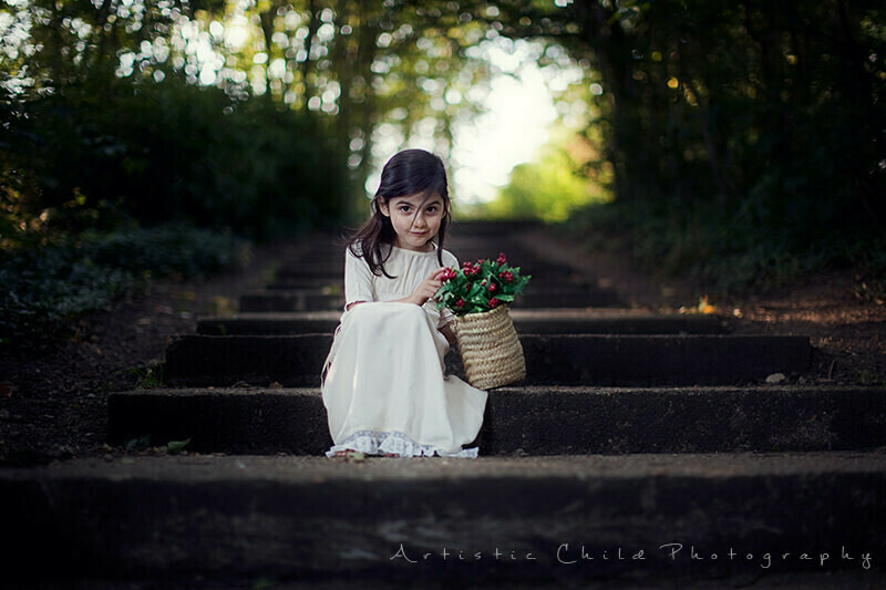 Professional London Kids Photographer | 4 year old girl sitting on steps in the park