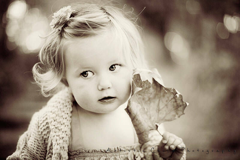 Black and White London Toddler Photography |close up portrait of a 1.5 year old girl with leaf