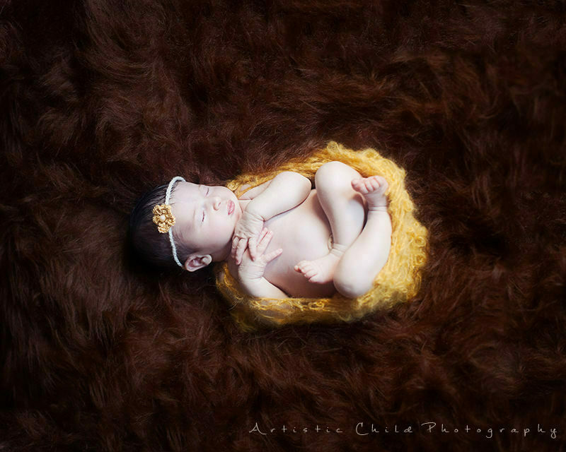 London Newborn Photography Services | 9 days old baby girl on brown flokati