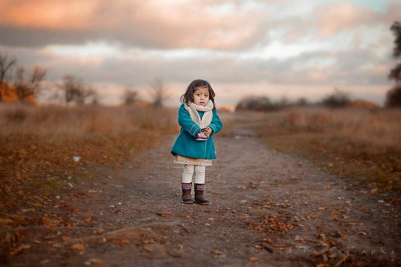Professional London Children Portraits | 2 year old girl standing in the middle of the path in Richmond Park during autumn season