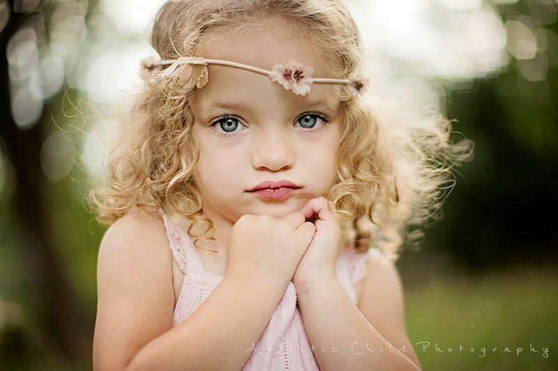 Professional London Toddler Photos | close up portrait of 2 year old bue eyed girl with curly hair