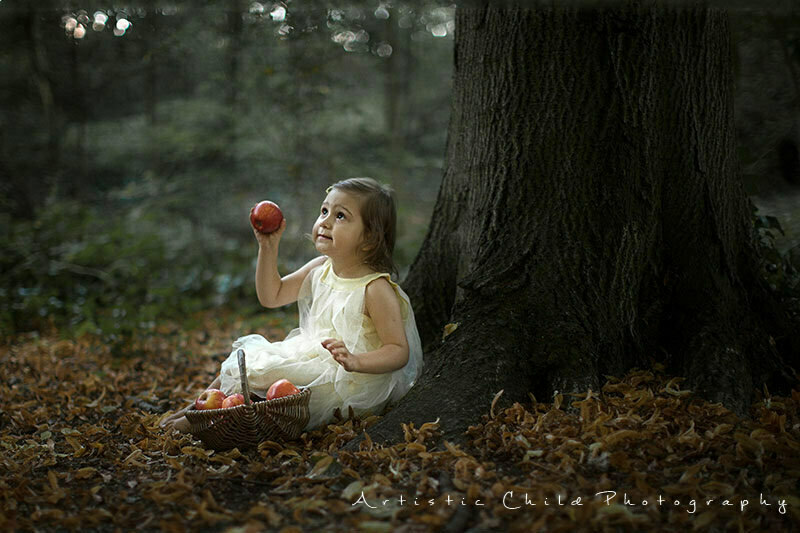 Professional London Children Photo Session | fairytale portrait of a girl with apples taken in Hampstead Heath Park