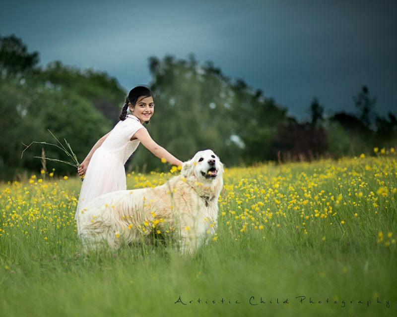 Professional London Children Photographer | 7 years old girl playing in the park with dog