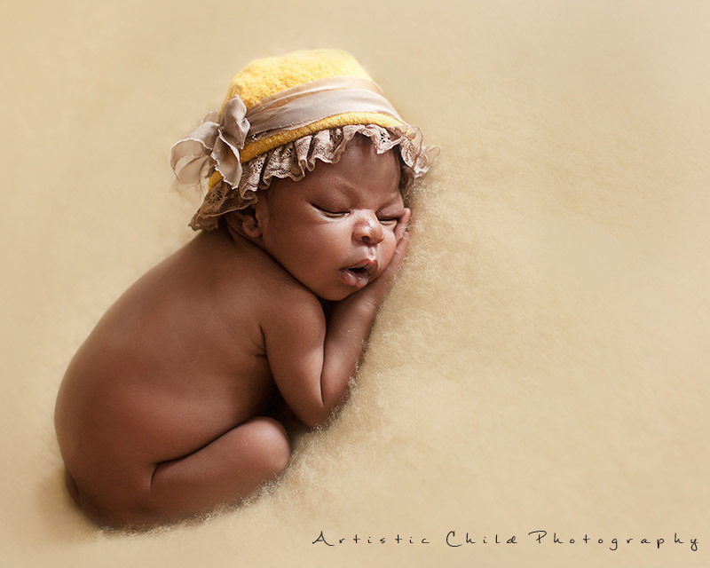 Beautiful London Newborn Photos   8 days old newborn baby girl in adobrable yellow hat
