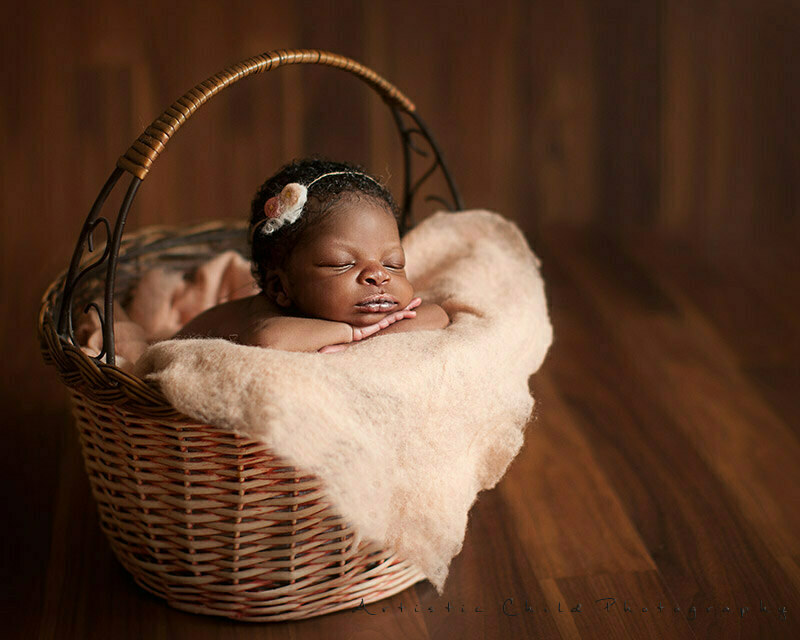 Beautiful London Newborn Photos | baby girl sleeping in a basket