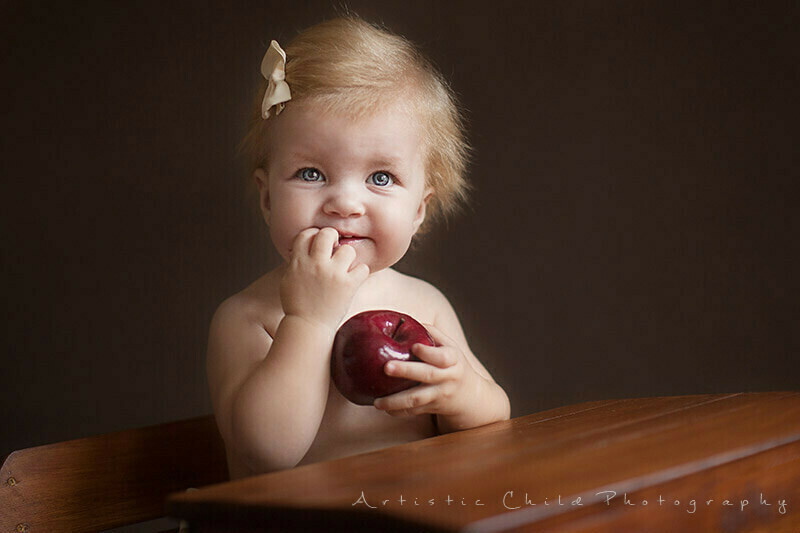 Best London Baby Photography | portrait of baby girl holding big red apple