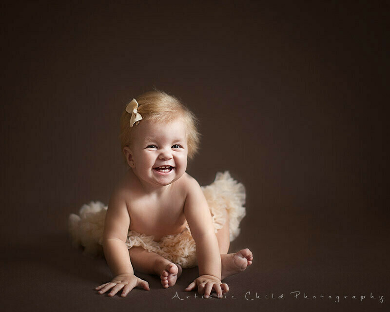 Best London Baby Photography | baby girl wearign tutu and smiling for the photo