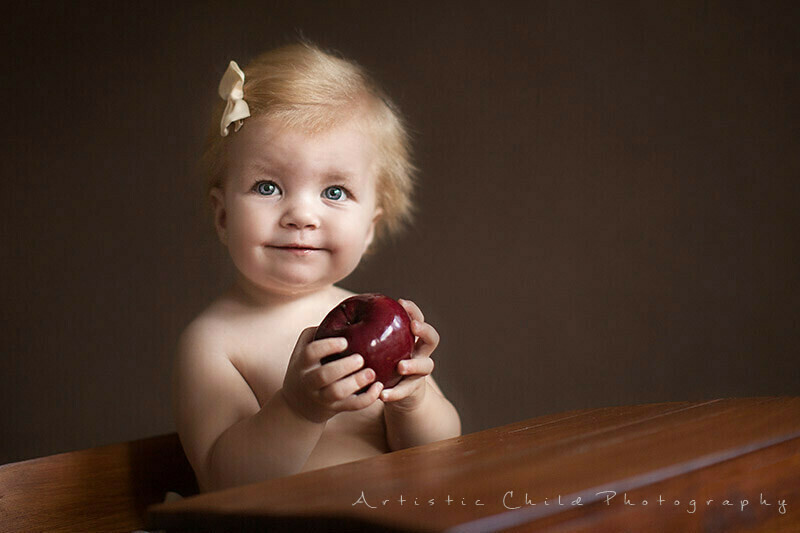 9 months old baby girl with a big red apple | London