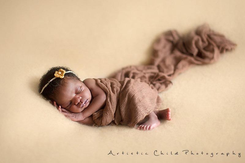 8 days old newborn baby girl sleeping in an angel pose | London