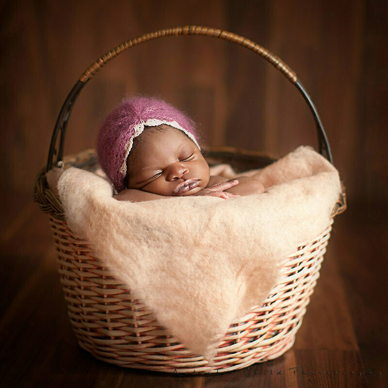newborn baby girl posed in a basket | London