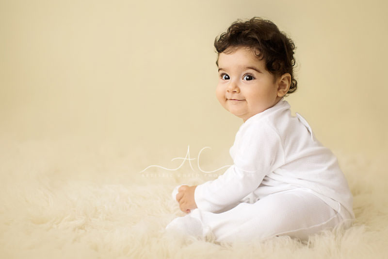 Artistic London Baby Photos | smily baby boy wearing white baby grow outfit