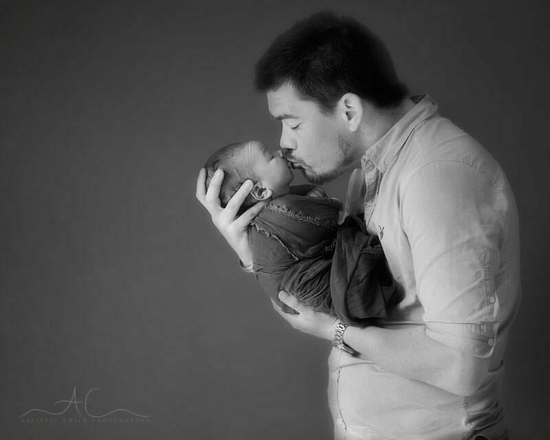 Beautiful London Family Photos | father kissing his newborn baby boy