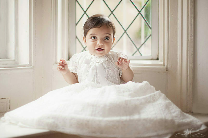 Professional London Baby Girl Photography| photo of 8 months old baby girl wearing Christening gown
