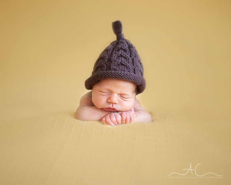 Professional London Newborn Pictures |portrait of newborn baby boy wearing a cute knitted brown hat