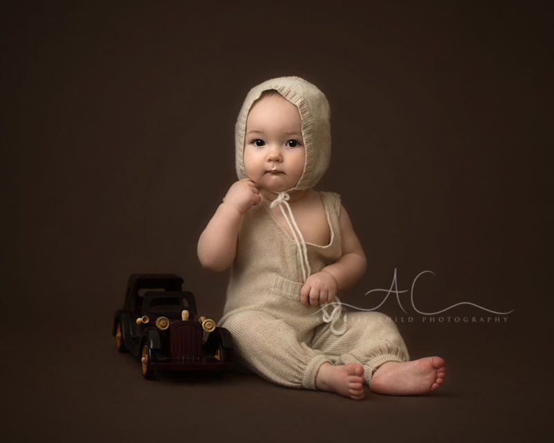 portrait of 8 months old baby boy and an old wooden car | South East London