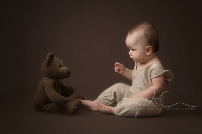 Best London Baby Photos | baby boy having a conversation with his teddy bear