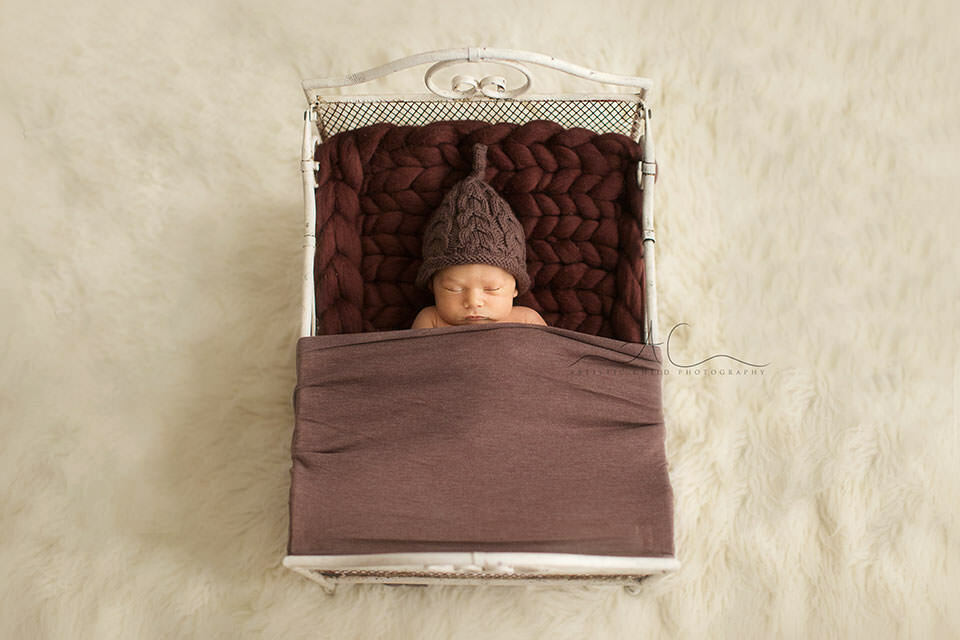 South East London Newborn Photographer | newborn baby boy sleeping in mini bed