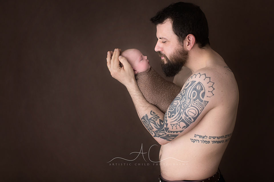 South East London Family Photography | father looking at his newborn baby girl