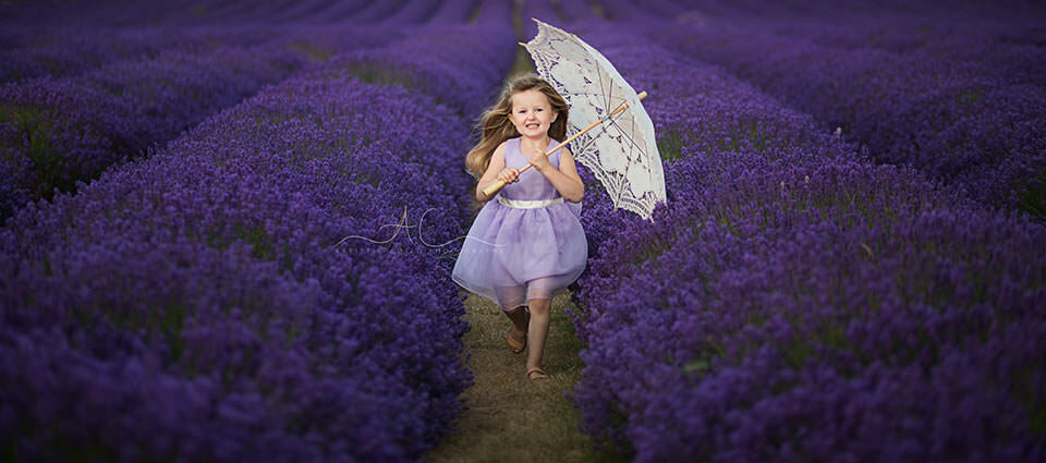 portrait of a girl with white umbrella running through lavender field | South East London