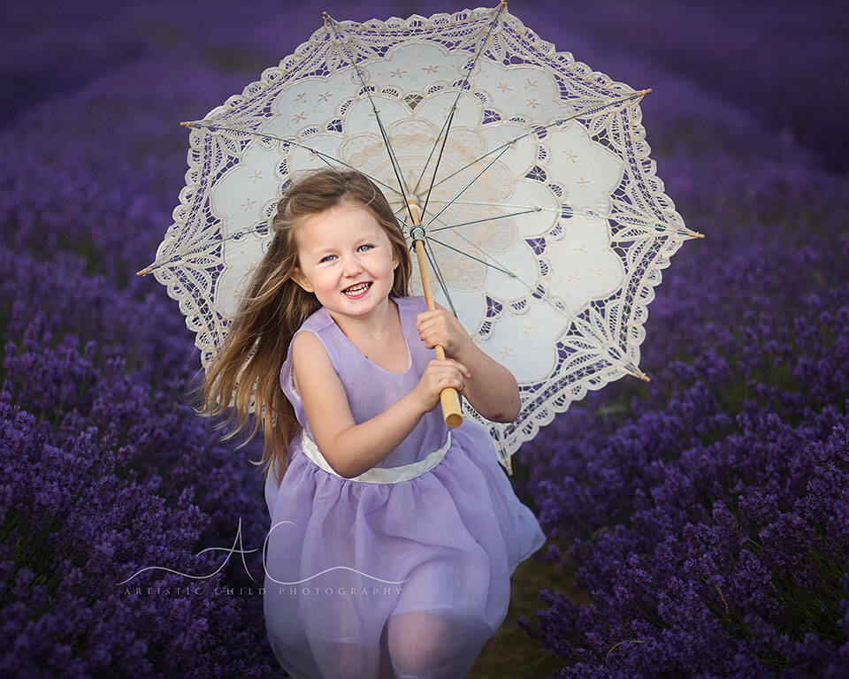 portrait of 4 year old girl with white umbrella taken in Lavender Field | South East London
