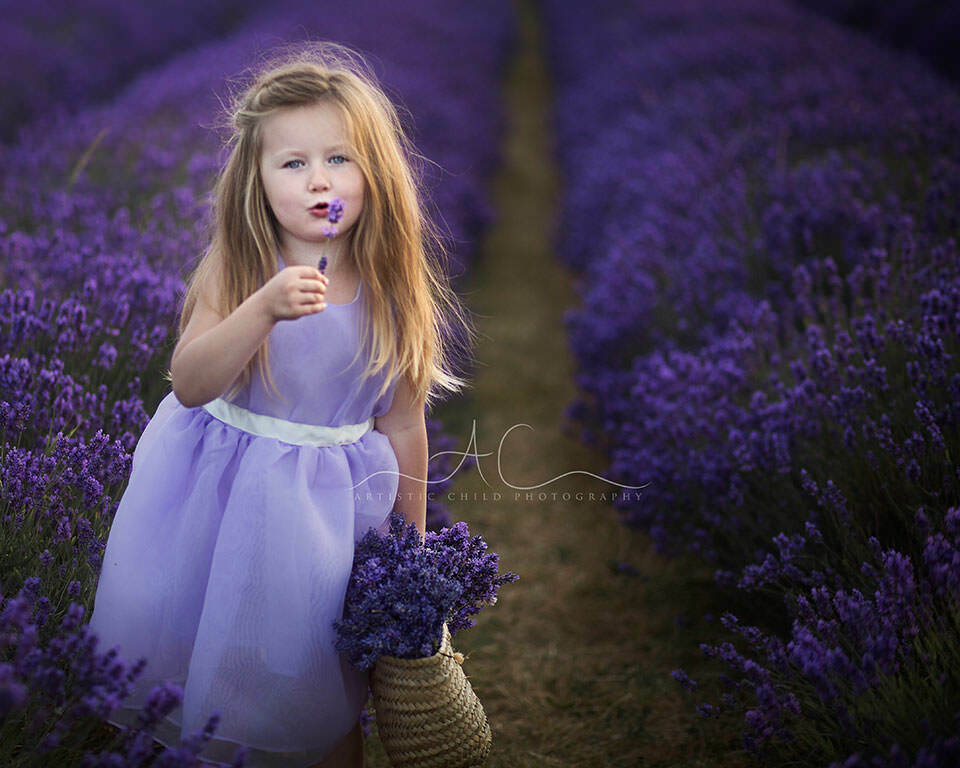 4 year old girl with lavender flower | South East London