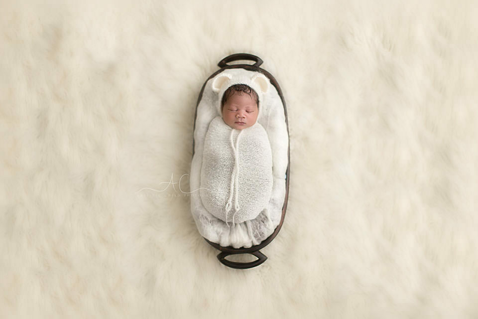 photo of a newborn baby boy in wooden trench bowl    London
