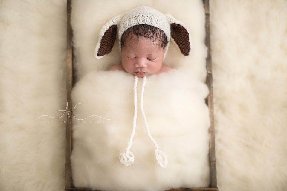 newborn baby boy wearing a funny hat   London
