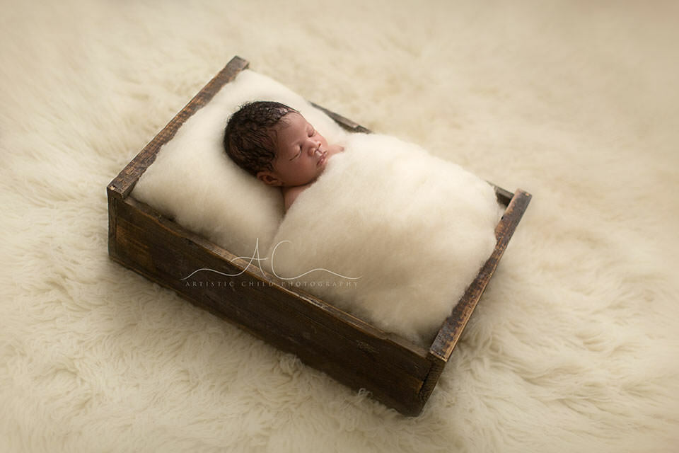 Professional London Newborn Portraits   newborn baby boy photographed in a wooden crate