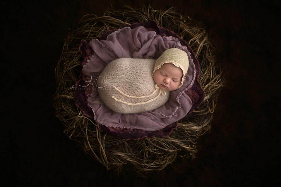 Professional London Newborn Photography | newborn baby girl sleeping in twig nest