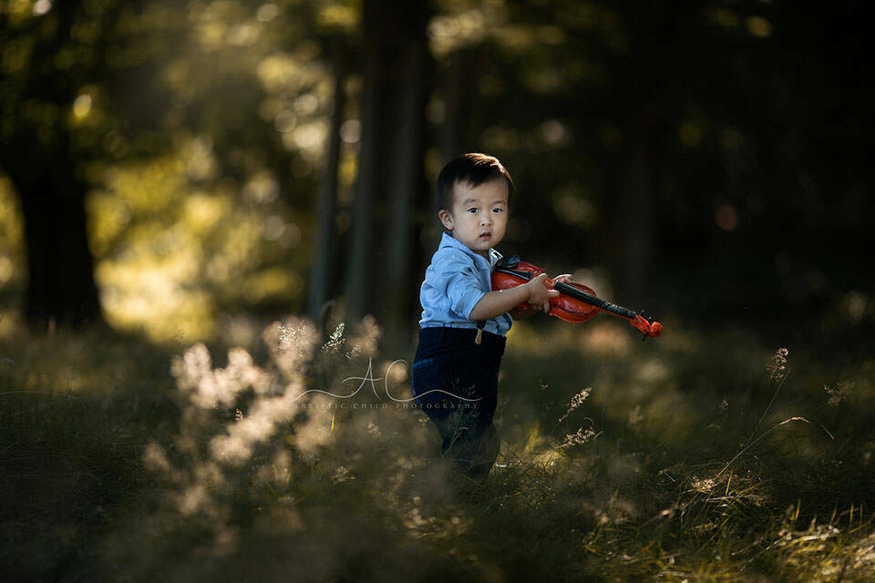 Professional London Toddler Images | 2 year old boy playing violin in the park