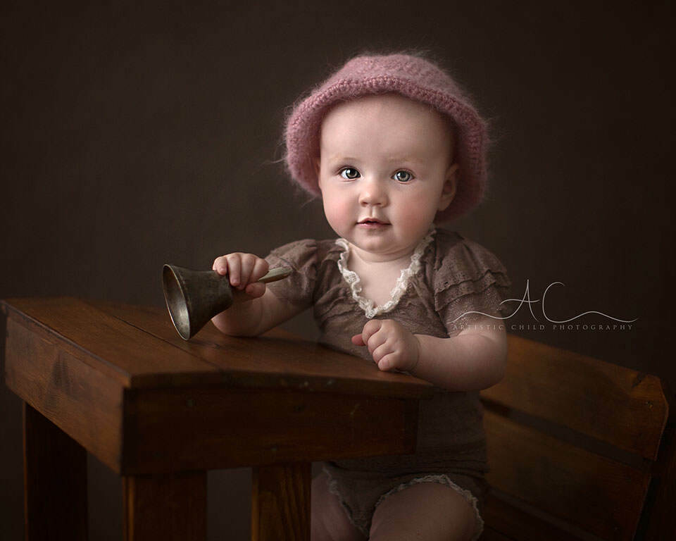 South East London Baby Photo Session | 8 months  old baby girl portrait with a metal bell